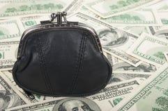 Geldbeutel und Dollar Stockfoto