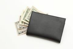 Gelddollars in zwarte portefeuille Stock Foto