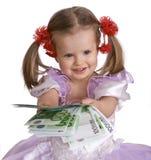 Geldeuro und Kindmädchen im Kleid. Stockbilder