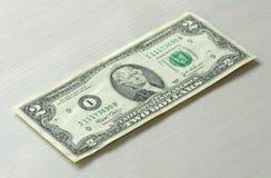 Geldfoto Zwei Dollar mit einer Anmerkung Stockbilder