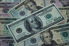 Geldhintergrund - Dollarscheine 100, 50, 20 Dollar Stockbild