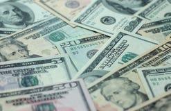 Geldhintergrund - unscharfe Dollar, amerikanisches Geld Stockbild
