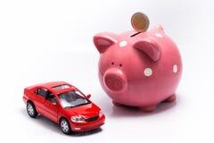 Geldkasten und ein Auto Lizenzfreie Stockfotografie