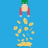 Geldmünze Magnet im Geschäftsmannhandkonzept Stockfotos