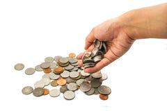 Geldmünzen mit Handweißhintergrund Lizenzfreie Stockfotografie