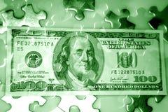 Geldpuzzlespiel Stockfotos