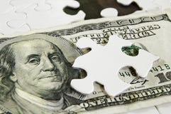 Geldpuzzlespiel Lizenzfreie Stockfotografie