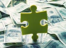 Geldpuzzlespiel Lizenzfreies Stockfoto
