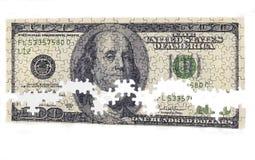 Geldpuzzlespiel Stockfoto