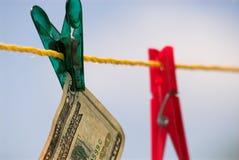 Geldreinigung Stockfoto