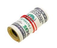Geldrolle mit den Dollarrechnungen getrennt auf Weiß Lizenzfreie Stockbilder