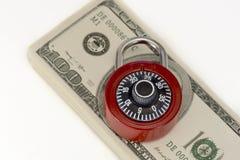 Geldsicherheitsschloss-Konzeptfoto Stockbild