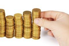 Geldstapel in der Hand lokalisiert auf weißem Hintergrund Lizenzfreies Stockfoto
