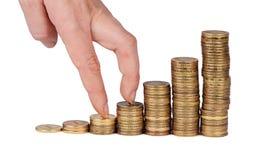 Geldstapel in der Hand lokalisiert auf weißem Hintergrund Stockfotografie