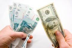 Geldumtausch Lizenzfreie Stockfotos