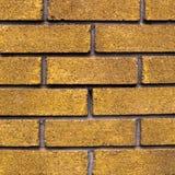 Gele bakstenen muur voor textuur of achtergrond Stock Foto