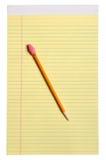 Gele Blocnote met Potlood Stock Afbeeldingen