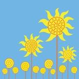Gele bloemen op blauwe achtergronden stock foto