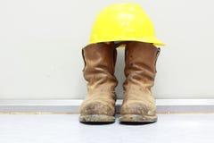 Gele bouwvakker en laarzen Stock Foto's