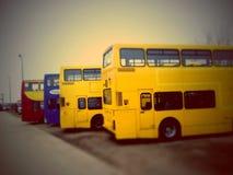 Gele bussen Stock Afbeeldingen