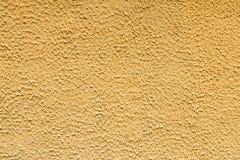Gele de textuurachtergrond van de pleistermuur Royalty-vrije Stock Foto
