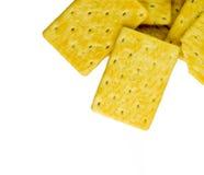 Gele die crackers op wit worden geïsoleerd Royalty-vrije Stock Afbeeldingen