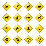 Gele dierlijke tekenpictogrammen stock foto