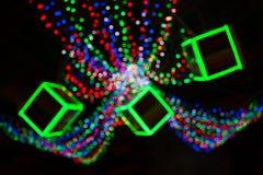 Gele, donkere, rode, blauwe achtergrond Kerstmislichten in bokeh Boken Royalty-vrije Stock Afbeeldingen