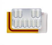 Gele doos met witte pillen in een blaarpak Stock Afbeelding