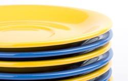 Gele en blauwe platen Stock Afbeeldingen