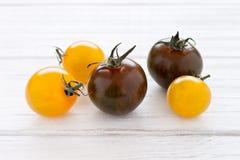 Gele en groene tomaten Stock Fotografie
