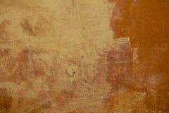 Gele en sinaasappel geschilderde oppervlakte Stock Foto's