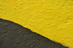 Gele en zwarte graffitisamenvatting Stock Foto's