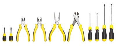 Gele en zwarte handige hulpmiddelen (heimachines en schroevedraaier) Stock Foto's