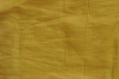 Gele gerimpelde stoffentextuur voor achtergrond Stock Afbeelding