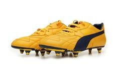 Gele geïsoleerde voetballaarzen Stock Foto