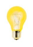 Gele gloeilamp die op witte achtergrond wordt geïsoleerd Stock Afbeeldingen