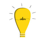 Gele gloeilamp met tekst binnen idee Stock Foto's