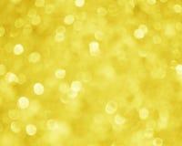 Gele Gouden Onduidelijk beeldachtergrond - het Beeld van de Kerstmisvoorraad Stock Foto's