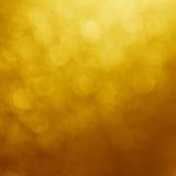Gele Gouden Onduidelijk beeldachtergrond - Voorraadfoto's Royalty-vrije Stock Afbeeldingen