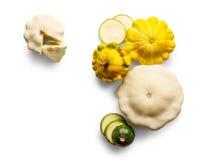Gele, groene en ronde die courgette op witte achtergrond wordt geïsoleerd Royalty-vrije Stock Foto