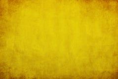Gele grungeachtergrond Royalty-vrije Stock Afbeeldingen