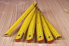 Gele houten meter Stock Foto's
