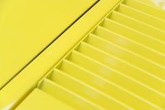 Gele kap stock afbeelding