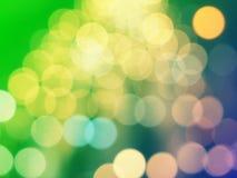 Gele Kerstmisachtergrond met bokehlichten Royalty-vrije Stock Fotografie