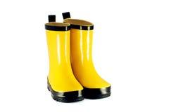 Gele kinderen` s laarzen Stock Afbeeldingen