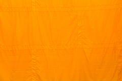 Gele klerenachtergrond Stock Afbeeldingen
