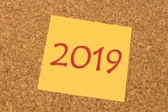 Gele kleverige nota - Nieuwjaar 2019 Stock Afbeeldingen