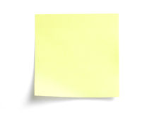 Gele kleverige nota over wit Royalty-vrije Stock Foto's