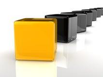 Gele kubus Stock Foto's